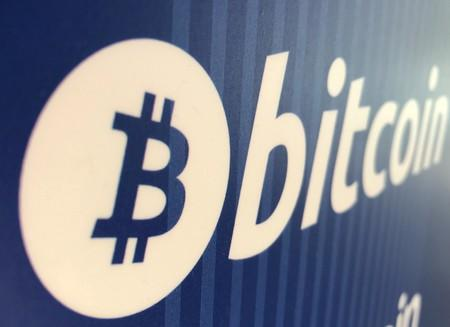 FILE PHOTO: A Bitcoin logo is seen on a cryptocurrency ATM in Santa Monica