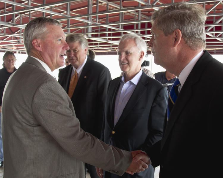 Secretary of Agriculture Tom Vilsack, right, shakes the hand of ethanol producer Duane Kristensen of Chief Ethanol Fuels in Hastings, Neb., left, as democratic senate candidate Bob Kerrey, center, looks on, following a meeting with agriculture producers in Omaha, Neb., Friday, Aug. 10, 2012. The federal government on Friday slashed its expectations for U.S. corn and soybean production for the second month in a row as the worst drought in decades continues punishing key farm states. (AP Photo/Nati Harnik)