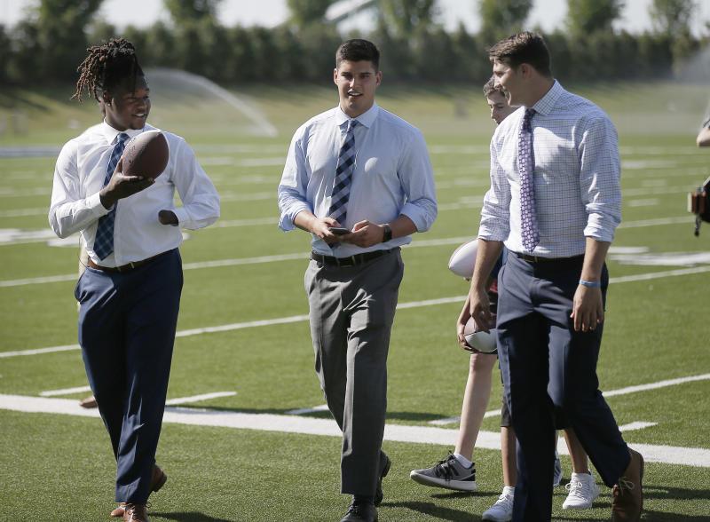 Shaquem Griffin (left), takes part in an NFL draft event in Frisco, Texas, with Mason Rudolph (middle) and Josh Allen. (AP)