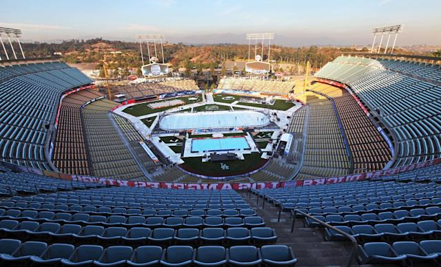 A hockey rink is ready at Dodger Stadium for the upcoming 2014 NHL Stadium Series hockey game in Los Angeles, Wednesday, Jan. 22, 2014. The Los Angeles Kings and Anaheim Ducks will play outdoors at Dodger Stadium, Saturday, Jan. 25th. (AP Photo/Nick Ut)