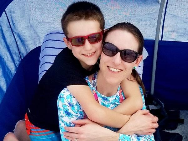Mom and son posing with sunglasses on