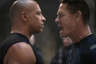 """This image released by Universal Pictures shows Vin Diesel, left, and John Cena in a scene from """"F9."""" (Giles Keyte/Universal Pictures via AP)"""