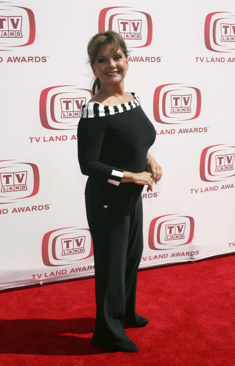 "FILE - In this June 8, 2008 file photo, actress Dawn Wells arrives at the TV Land Awards in Santa Monica, Calif. Wells, who played the wholesome Mary Ann among a misfit band of shipwrecked castaways on the 1960s sitcom ""Gilligan's Island, died Wednesday, Dec. 30, 2020, of causes related to COVID-19, her publicist said.(AP Photo/Mark Mainz, File)"