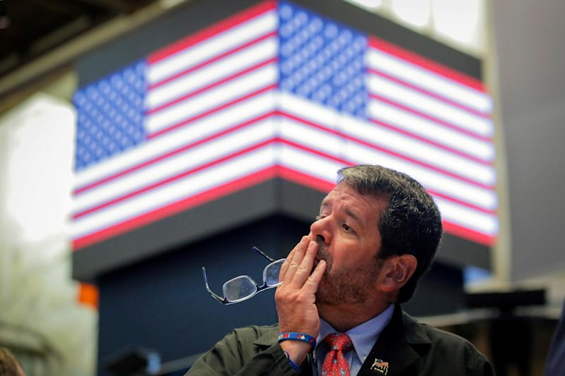 A trader works on the floor at the New York Stock Exchange (NYSE) in New York, U.S., August 5, 2019. REUTERS/Brendan McDermid