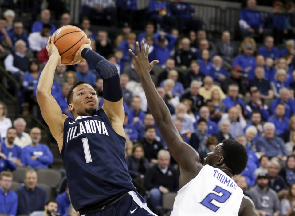 FILE- In this Feb. 24, 2018, file photo, Villanova's Jalen Brunson (1) shoots over Creighton's Khyri Thomas (2) during the first half of an NCAA college basketball game in Omaha, Neb. Brunson was selected as one of the top college basketball players of the decade. (AP Photo/Nati Harnik, File)