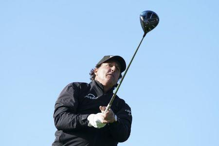FILE PHOTO: February 10, 2019; Pebble Beach, CA, USA; Phil Mickelson hits his tee shot on the ninth hole during the final round of the AT&T Pebble Beach Pro-Am golf tournament at Pebble Beach Golf Links. Mandatory Credit: Kyle Terada-USA TODAY Sports