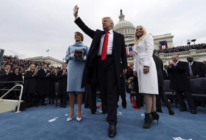 <p>President Donald Trump acknowledges the audience after taking the oath of office as his wife Melania (L) and daughter Tiffany watch during inauguration ceremonies swearing in Trump as the 45th president of the United States on the West front of the U.S. Capitol in Washington, DC. January 20, 2017. (Photo: Jim Bourg – Pool/Getty Images) </p>