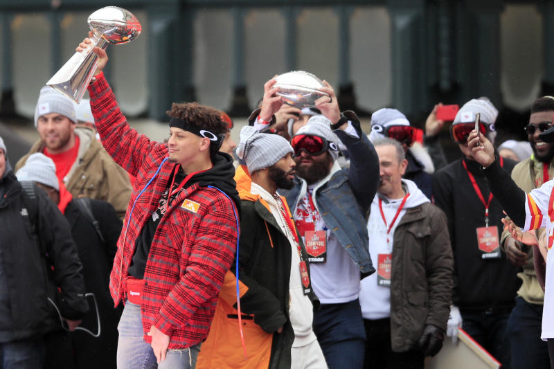 Kansas City Chiefs quarterback Patrick Mahomes holds the Vince Lombardi Trophy during a Super Bowl rally. (AP Photo/Orlin Wagner)