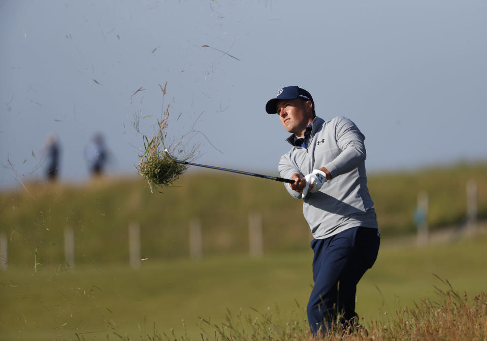 United States' Jordan Spieth plays from the rough on the 14th fairway during the second round of the British Open Golf Championship at Royal St George's golf course Sandwich, England, Friday, July 16, 2021. (AP Photo/Peter Morrison)