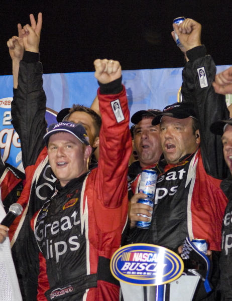 FILE - In this July 28, 2007 file photo, driver Jason Leffler, left, of Mooresville, N.C., gestures after winning the Kroger 200 NASCAR Busch Series auto race in Clermont, Ind. Leffler died after an accident in a heat race at a dirt car event at Bridgeport Speedway in Swedesboro, N.J., Wednesday night, June 12, 2013, New Jersey State Police said. (AP Photo/Seth Rossman, File)