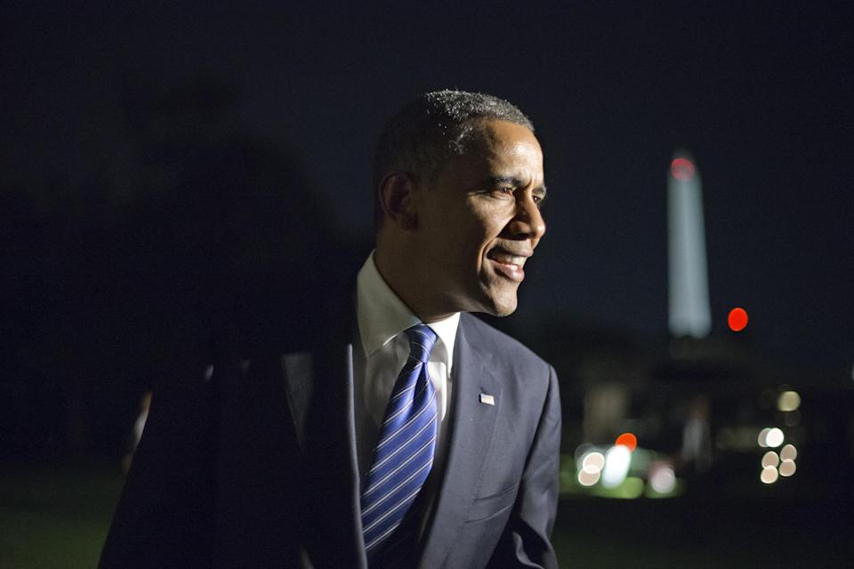 """Remarking on the vice presidential debate, President Barack Obama tells reporters, """"I think Joe Biden did great. I couldn't be prouder,"""" as he returns to the White House in Washington after a day of campaign events in Miami, Thursday night, Oct. 11, 2012. (AP Photo/J. Scott Applewhite)"""