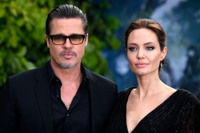 Brad Pitt and Angelina Jolie attending a premiere in London in 2014