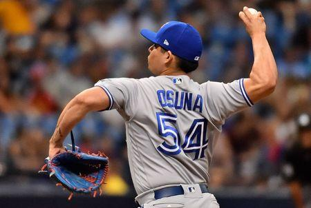 May 6, 2018; St. Petersburg, FL, USA; Toronto Blue Jays relief pitcher Roberto Osuna (54) delivers a pitch in the eighth inning against the Tampa Bay Rays at Tropicana Field. Mandatory Credit: Jasen Vinlove-USA TODAY Sports