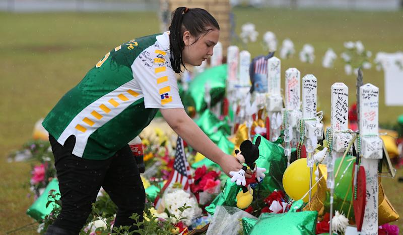 A student mourns those killed in the recent shooting at Santa Fe High School.