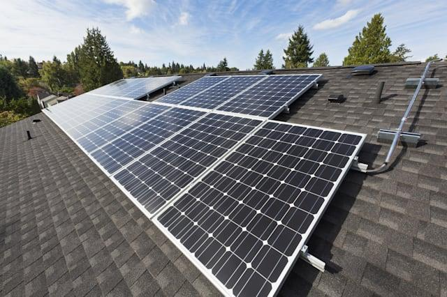 Solar panels fixed on the rooftop of a house