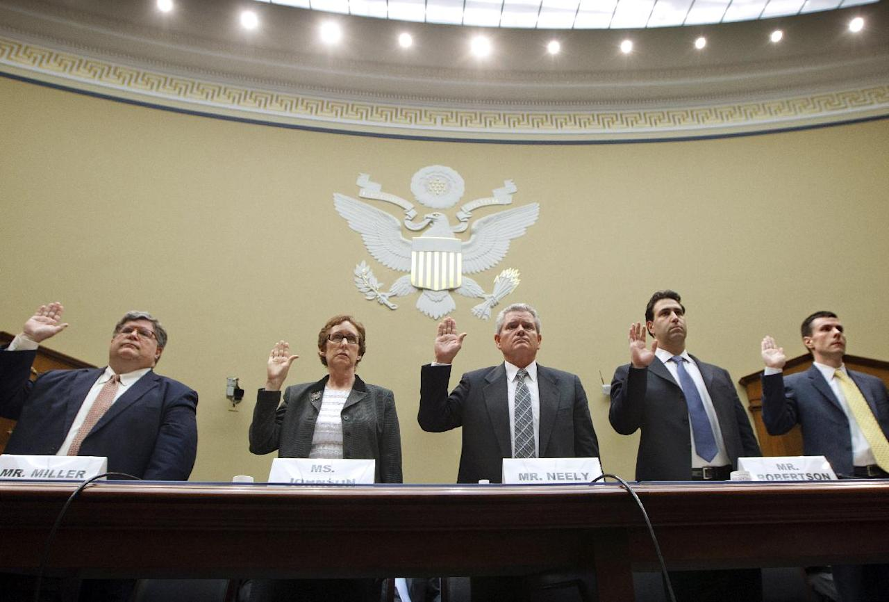 The House Committee on Oversight and Government Reform conducts the first hearing on incidents of wasteful spending by the General Services Administration, the real estate agency for federal buildings, on Capitol Hill in Washington, Monday, April 16, 2012. Being sworn in to testify, from left are, GSA Inspector General Brian Miller, former GSA Administrator Martha Johnson, Jeff Neely, former regional commissioner of the Public Buildings Service, Pacific Rim Region, GSA Chief of Staff Michael Robertson, and David Foley, deputy commissioner of the GSA Public Buildings Service. (AP Photo/J. Scott Applewhite)