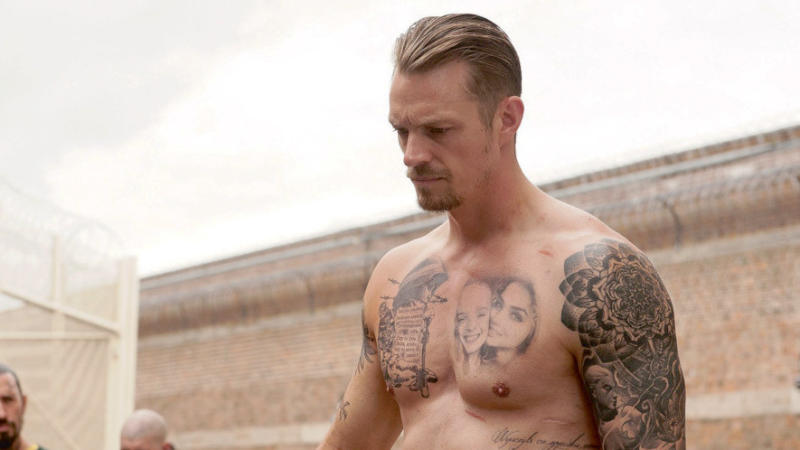 Joel Kinnaman in 'The Informer'. (Credit: Warner Bros)