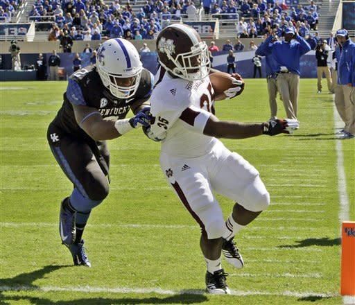 Mississippi State fullback Adrian Marcus (35) outruns Kentucky defender Alvin Dupree (2) to the end zone to score on a 10-yard pass and run touchdown during the first half of an NCAA college football game in Lexington, Ky., Saturday, Oct. 6, 2012. (AP Photo/Garry Jones)