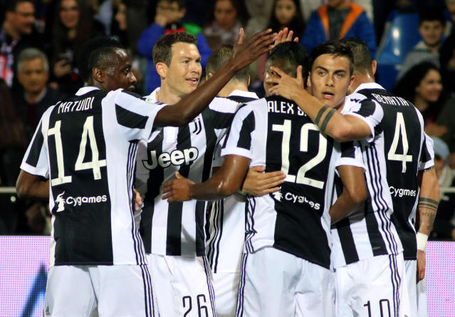 Juventus' Alex Sandro, 3rd from right, celebrates with his teammates after scoring during the Serie A soccer match between Crotone and Juventus, at the Ezio Scida stadium in Crotone, Italy, Wednesday, April 18, 2018. 18 (Albano Angilletta/ANSA via AP)