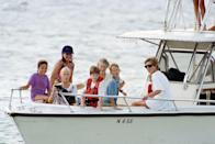 <p>Headlines are made with the publication of Prince of Wales's private conversation with Camilla Parker Bowles, and when the Duke and Duchess of York announce their separation. Here, Princess Diana takes Princes Harry and William on vacation.</p>