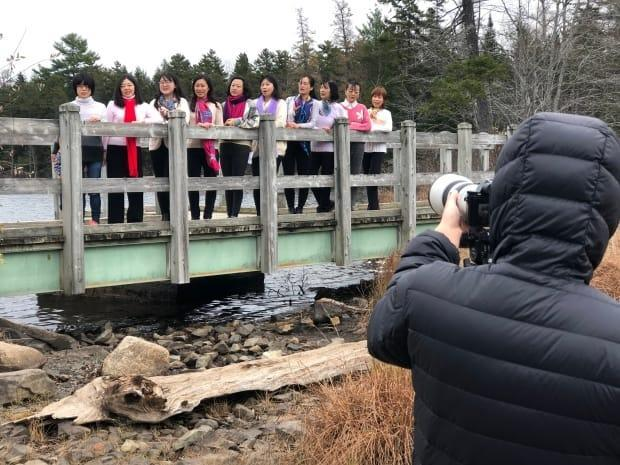 Members of the Chinese Cultural Association of New Brunswick were filming part of the online Chinese New Year gala at Killarney Lake in November.