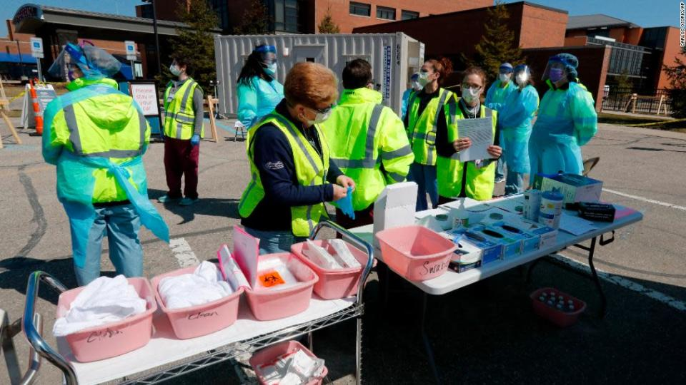 """<p>Healthcare workers prepare their supplies at a COVID-19 drive-thru testing site at Henry Ford West Bloomfield Hospital, Wednesday, March 25, 2020, in West Bloomfield, Mich. (AP Photo/Carlos Osorio)</p> <div class=""""cnn--image__credit""""><em><small>Credit: Carlos Osorio/AP / Associated Press</small></em></div>"""