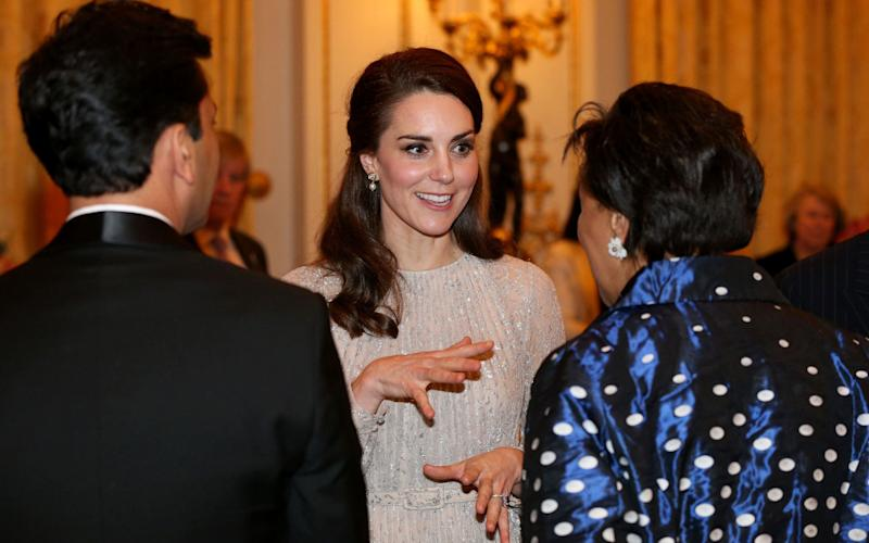Erdem, believed to be the designer of Miss Markle's dress, is a favourite of the Duchess of Cambridge's, who this week wore a metallic design for a reception at Buckingham Palace - Credit: Jonathan Brady/PA Wire