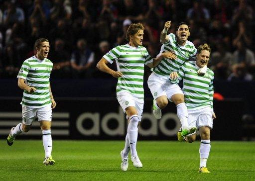 Celtic's Kris Commons (R) celebrates with teammates Adam Matthews (L), Thomas Rogne and Beram Kayal (2R) after scoring a goal during their Champions League play-off match against Helsingborgs on August 21