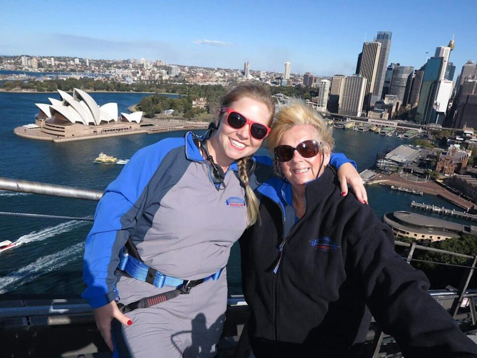 At the top of the Sydney Harbor Bridge Climb with his mother, Chris Woods: