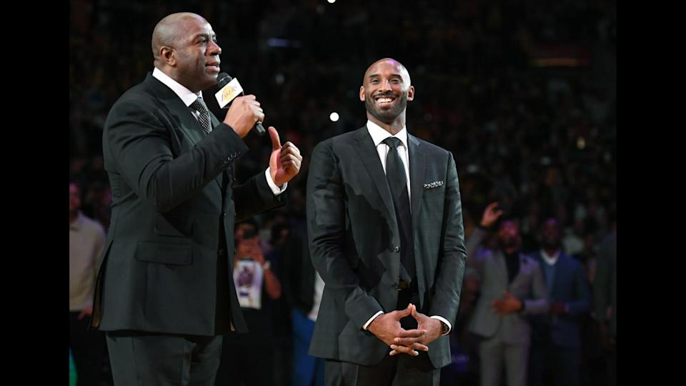 Former Lakers guard Magic Johnson, left, praises Kobe Bryant during the ceremony to retire his two jerseys on Dec. 18, 2017.