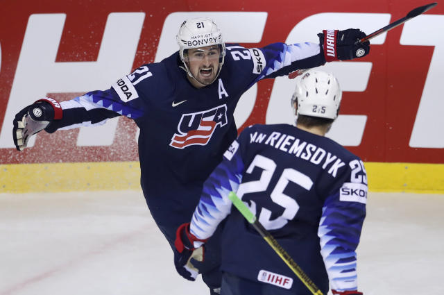 Dylan Larkin of the US, left, celebrates with James van Riemsdyk of the US, right, after scoring his sides second goal during the Ice Hockey World Championships group A match between Germany and the United States at the Steel Arena in Kosice, Slovakia, Sunday, May 19, 2019. (AP Photo/Petr David Josek)