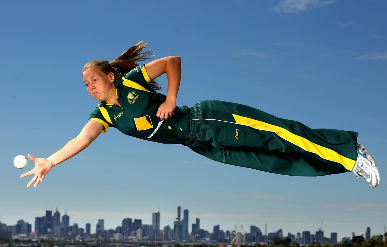 MELBOURNE, AUSTRALIA - OCTOBER 27:  Victorian and Australian women's cricket team representative Meg Lanning dives for a catch during a photo shoot at Quarry Park on October 27, 2011 in Melbourne, Australia.  (Photo by Mark Dadswell/Getty Images)