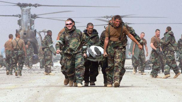 PHOTO: U.S. Army soldiers from the 3rd Infantry Division carry a wounded Iraqi prisoner of war to the battalion aid station on a captured airfield in southern Iraq, March 24, 2003. (Romeo Gacad/AFP via Getty Images, FILE)