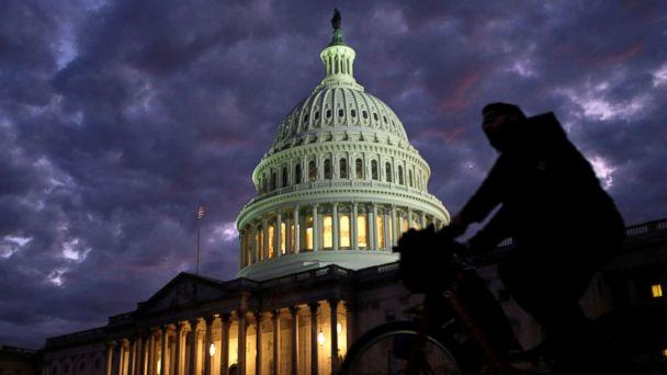 PHOTO: Cyclists ride past the U.S. Capitol dome in Washington on midterm election day, Nov. 6, 2018. (James Lawler Duggan/Reuters)