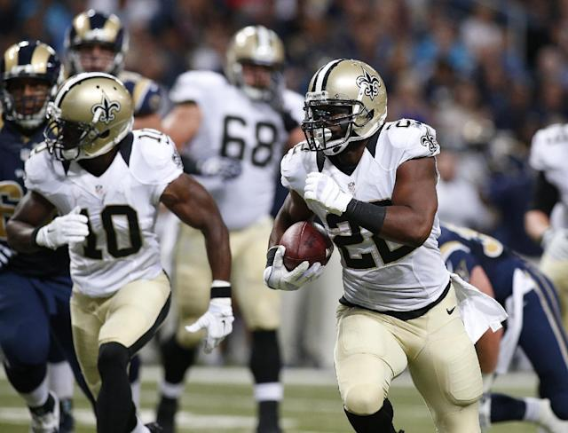 New Orleans Saints running back Mark Ingram (22) runs 22 yards for a touchdown against the St. Louis Rams in the second quarter of a preseason NFL football game Friday, Aug. 8, 2014, in St. Louis. (AP Photo/Scott Kane)