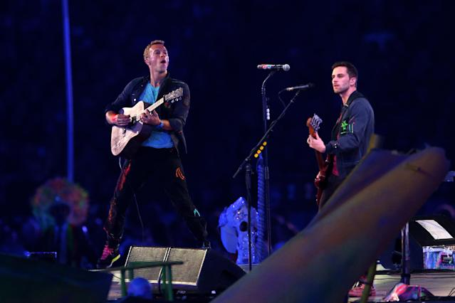 LONDON, ENGLAND - SEPTEMBER 09: Chris Martin (L) and Guy Berryman of Coldplay perform during the closing ceremony on day 11 of the London 2012 Paralympic Games at Olympic Stadium on September 9, 2012 in London, England. (Photo by Hannah Johnston/Getty Images)