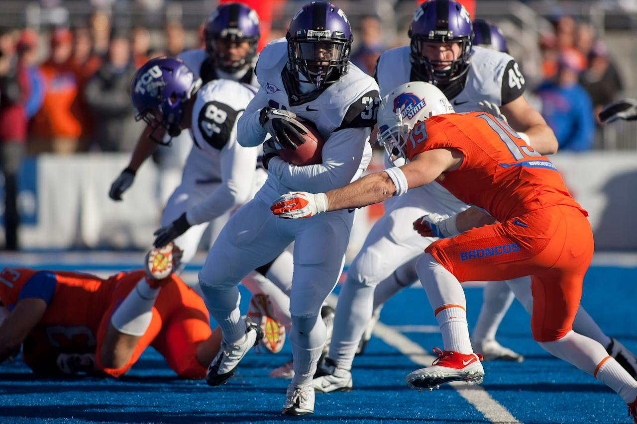 BOISE, ID - NOVEMBER 12:  Waymon James #32 of the TCU Horned Frogs runs the ball against the Boise State Broncos at Bronco Stadium on November 12, 2011 in Boise, Idaho.  (Photo by Otto Kitsinger III/Getty Images)