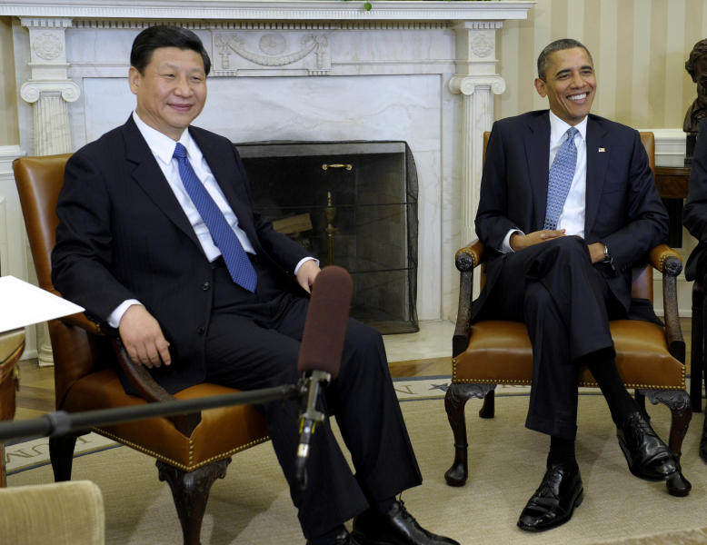 FILE - In this Feb. 14, 2012 file photo, U.S. President Barack Obama, right, meets with then Chinese Vice President Xi Jinping in the Oval Office of the White House in Washington. Obama and Xi, now Chinese president, face weighty issues when they meet at a private estate in California early June 2013, but their most important task may simply be establishing a strong rapport. (AP Photo/Susan Walsh, File)
