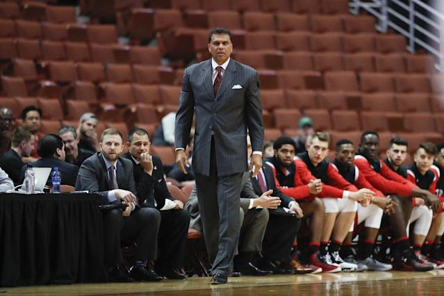 "Reggie Theus was fired by Cal State Northridge on Wednesday, but not before he the also-fired athletic director <a class=""link rapid-noclick-resp"" href=""/ncaaf/players/268791/"" data-ylk=""slk:Brandon Martin"">Brandon Martin</a> reportedly got into an altercation. (AP Photo)"