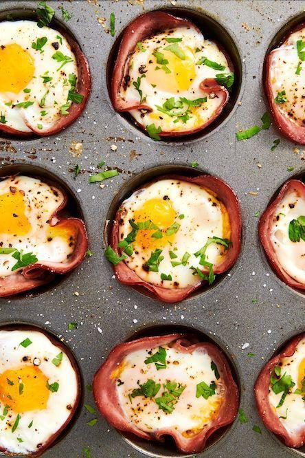 """<p>This low-carb breakfast comes together in no time—seriously, you only need 20-ish minutes! If you like your eggs super runny, you might want to pull them from the oven a minute before you think they're ready. You'll need to let them rest for a bit in the muffin tin before taking them out (they'll be HOT), and during these few minutes, the eggs will continue to cook slightly.</p><p>Get the <a href=""""https://www.delish.com/uk/cooking/recipes/a29030029/ham-cheese-egg-cups-recipe/"""" rel=""""nofollow noopener"""" target=""""_blank"""" data-ylk=""""slk:Ham & Cheese Egg Cups"""" class=""""link rapid-noclick-resp"""">Ham & Cheese Egg Cups</a> recipe. </p>"""