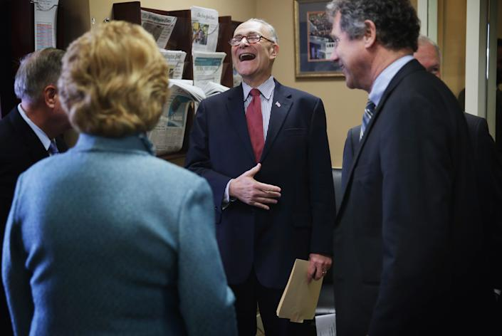 Sen. Charles Schumer (D-N.Y.) (3rd L) laughs as he talks to (L-R) Sen. Lindsey Graham (R-S.C.), Sen. Debbie Stabenow (D-Mich.), Sen. Sherrod Brown (D-Ohio) and Sen. Jeff Sessions (R-Ala.) before a news conference on currency and trade Feb. 10, 2015, on Capitol Hill.