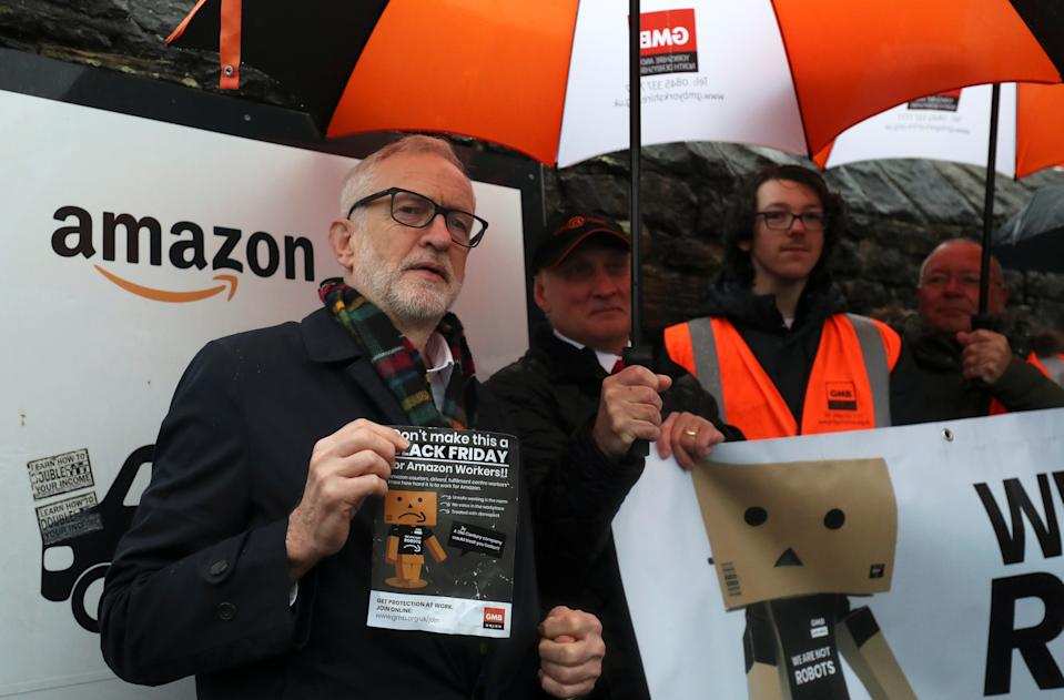 Britain's Labour Party leader Jeremy Corbyn stands outside Amazon's depot in Sheffield, Britain, November 23, 2019. REUTERS/Scott Heppell