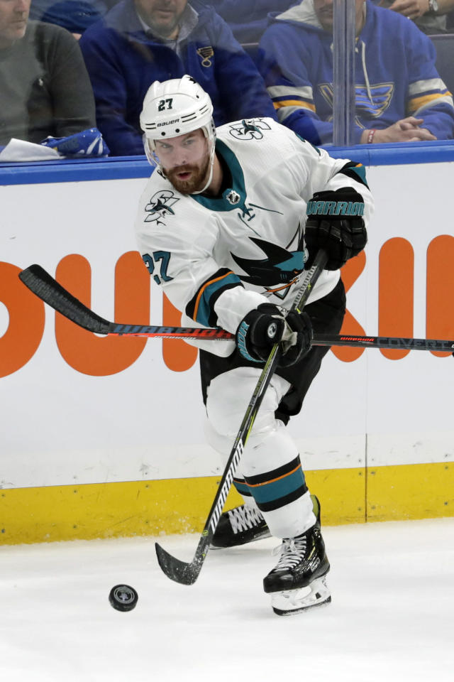 FILE - In this May 21, 2019, file photo, San Jose Sharks right wing Joonas Donskoi (27), of Finland, passes the puck against the St. Louis Blues during the first period in Game 6 of the NHL hockey Stanley Cup Western Conference final series in St. Louis. A person with knowledge of the move says the Colorado Avalanche have agreed to sign winger Joonas Donskoi to a $15.6 million, four-year deal with an annual salary-cap hit of $3.9 million. The person spoke to The Associated Press on condition of anonymity because the deal had not been announced. (AP Photo/Tom Gannam, File)