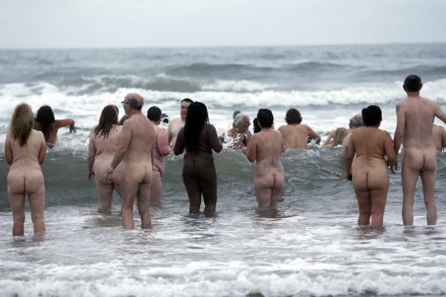 Hundreds strip off for annual skinny dip