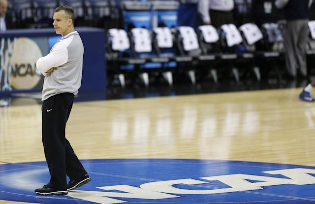 Florida head coach Billy Donovan, watches his team during practice at the NCAA college basketball tournament, Wednesday, March 26, 2014, in Memphis, Tenn. Florida plays UCLA in a regional semifinal on Thursday. (AP Photo/John Bazemore)