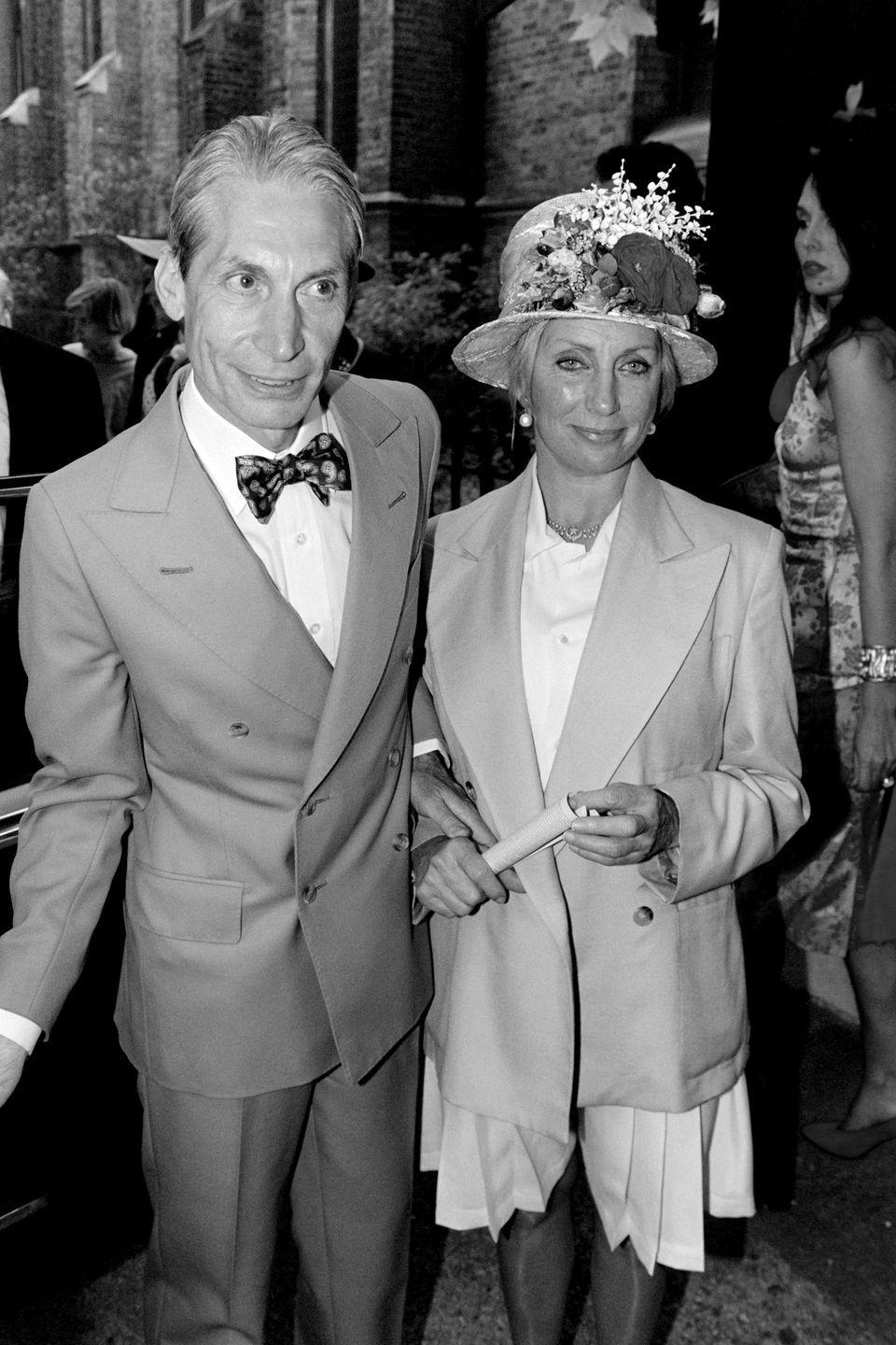 <p>Charlie Watts and his wife Shirley Ann Shepherd, attend Georgia May Jagger's christening at Saint Andrew's church, Richmond in 1992.</p>