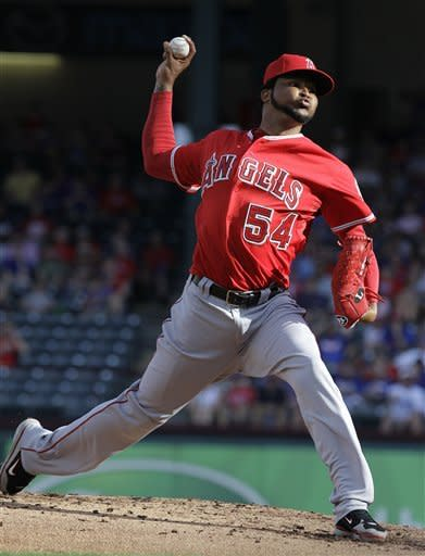 Los Angeles Angels starting pitcher Ervin Santana (54) throws during the first inning of a baseball game against the Texas Rangers Monday, July 30, 2012, in Arlington, Texas. (AP Photo/LM Otero)