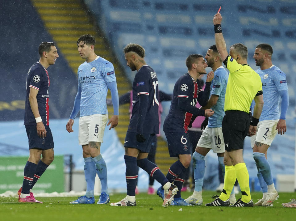 PSG's Angel Di Maria, left, is shown a red card during the Champions League semifinal second leg between Manchester City and Paris Saint Germain. (AP Photo/Dave Thompson)