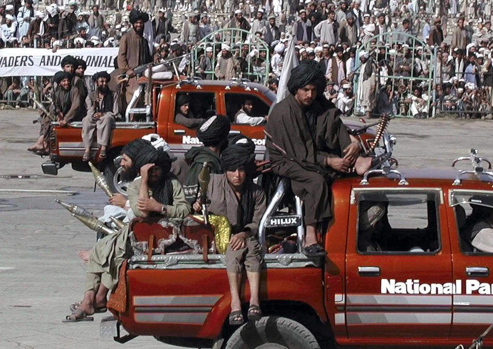 FILE - In this Sunday, Aug. 19, 2001, file photo, Taliban militants celebrate Afghanistan's Independence Day in Kabul, Afghanistan, just three months before the U.S.-led coalition ousted their regime from power. Today the Taliban are engaged in talks with President Hamid Karzai's opposition and previously held talks with the United State. However talks between the U.S. and the Taliban broke down last year after the U.S. rejected Taliban demands to release five prisoners from Guantanamo Bay, Cuba. (AP Photo/B.K. Bangash, File)