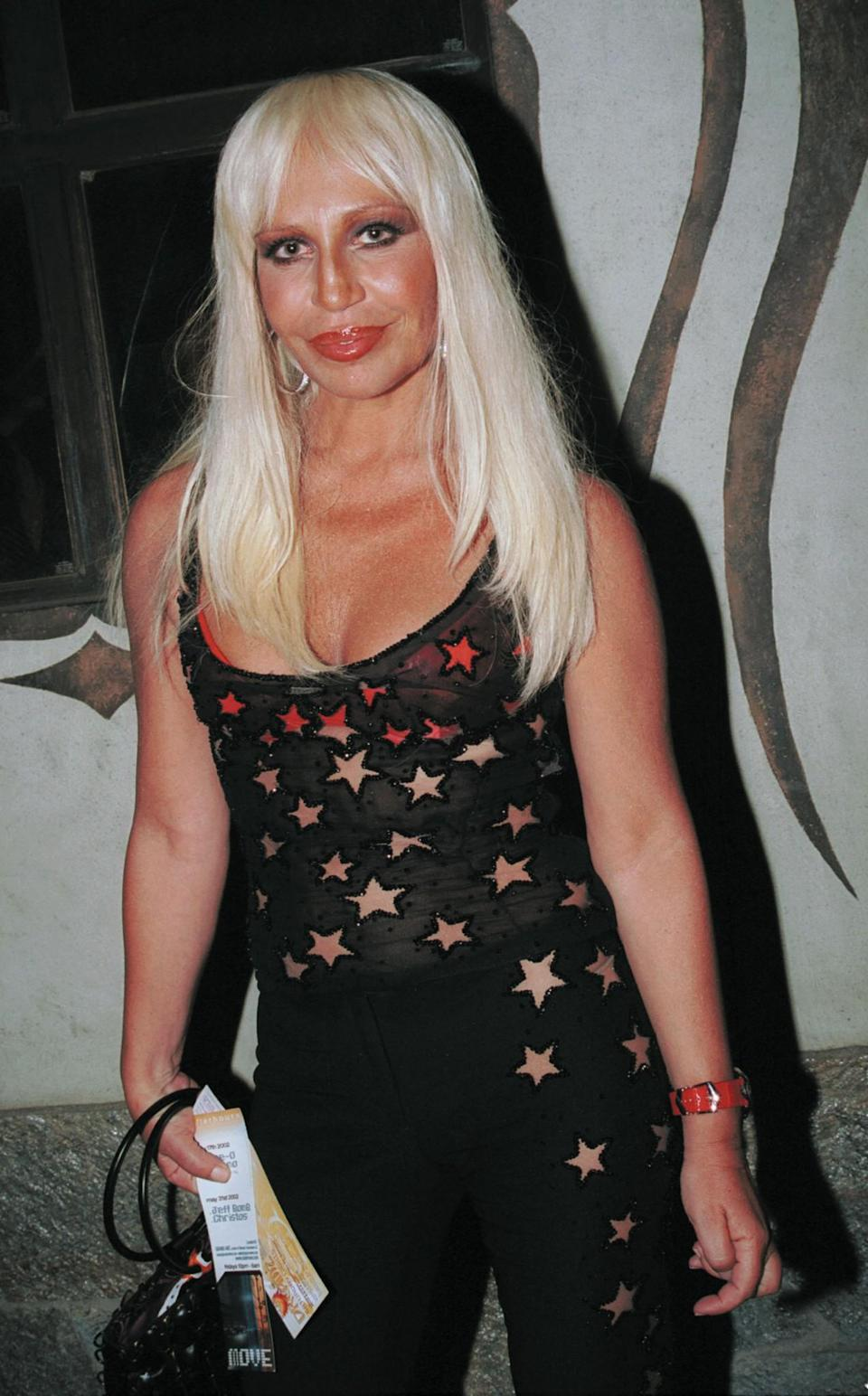 <p>Donatella appears much less natural with a sculpted face, fuller lips and smoother skin. <i>[Photo: Getty]</i> </p>